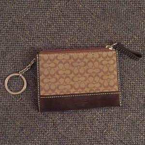 Like new genuine Coach brown key ring wallet